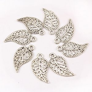 Charm, antiqued silver-finished inchpewterinch (zinc-based alloy), 10x19mm leaf. Sold per pkg of 50.
