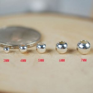 Bead, sterling silver, 4mm seamless smooth round. Sold per pkg of 10.