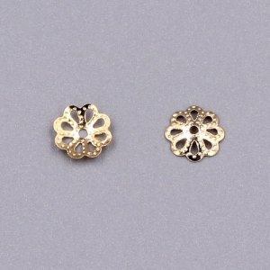 Bead cap, rose gold plated iron, 7x1mm textured flower with cutouts, fits 8-12mm bead. Sold per pkg of 200.