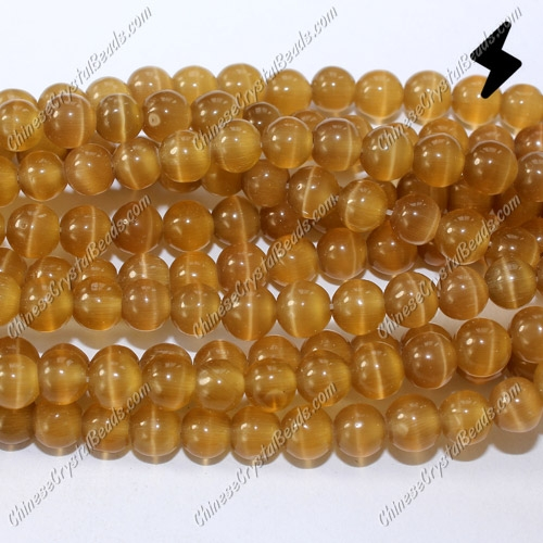 "glass cat eyes beads strand, amber, about 15"" longer"