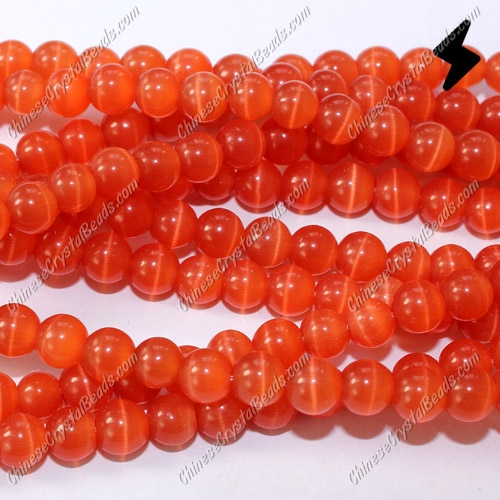 "glass cat eyes beads strand, red, about 15"" longer"