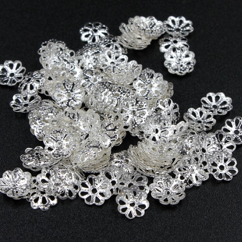 Bead cap, silver plated iron, 7x1mm textured flower with cutouts, fits 8-12mm bead. Sold per pkg of 200.